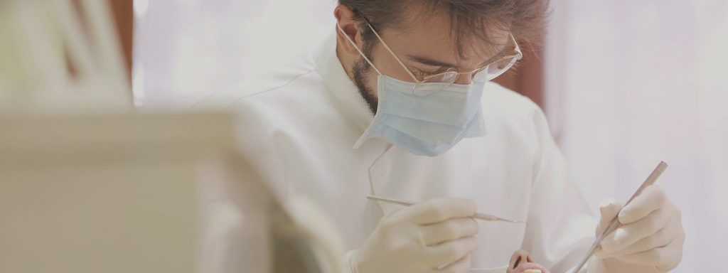 Dental Hygienist Working on Patient Oral Care